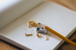 A photo showing notebook, pencil and sharpener, all essential training tools