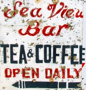 vintage, weathered sign saying Sea View bar, Tea and coffee, open daily