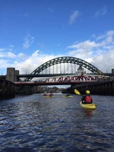 Kakaks paddling beneath the High Level Bridge on the Tyne