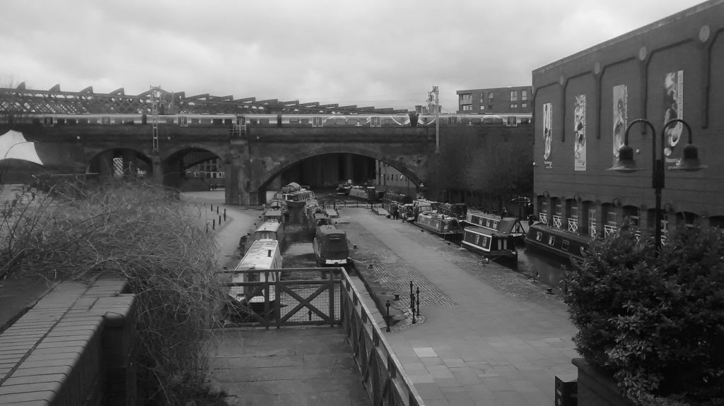 black and white photo of Manchester canal and railway