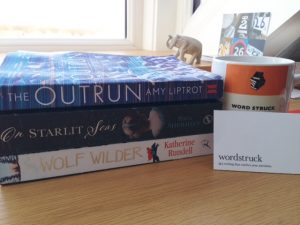 Pile of books I read in 2016 - The Wolf Wilder, On Starlit Seas, The Outrun