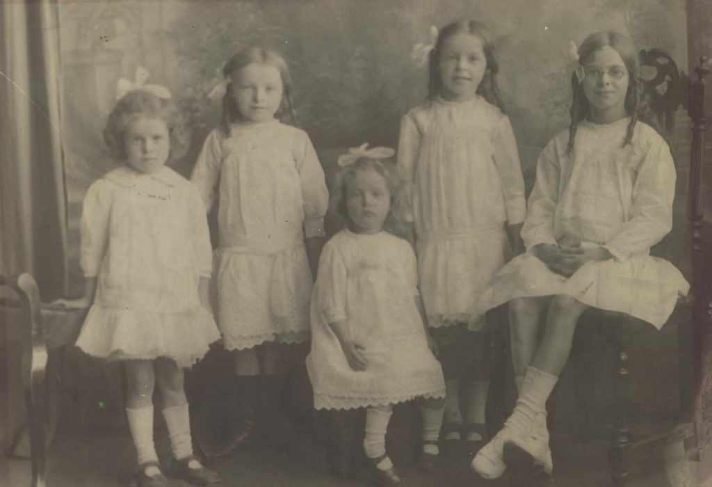 Black and white photograph of five young girls in 1918